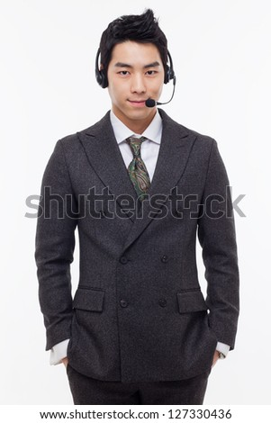 Asian business customer support operator man smiling isolated on white background.