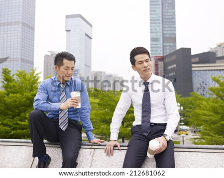 asian business executives having a bad day. - stock photo