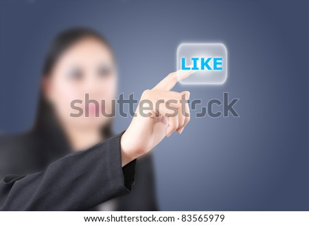 Asian business lady pushing like word. - stock photo