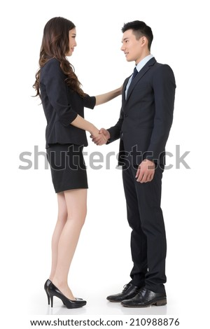Asian business man and woman shake hands, full length portrait isolated on white background. - stock photo