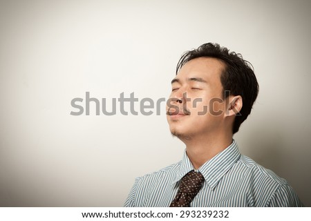 asian business man breathing and smiling isolated. - stock photo