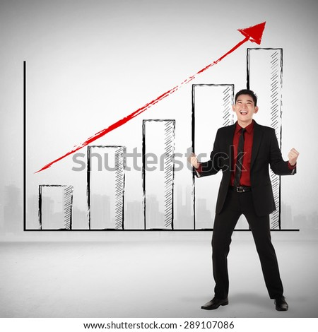 Asian business man happy about sales increasing - stock photo