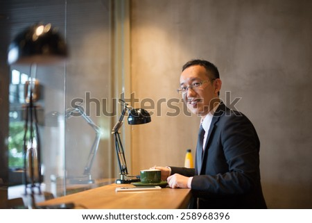 asian business man having coffee - stock photo