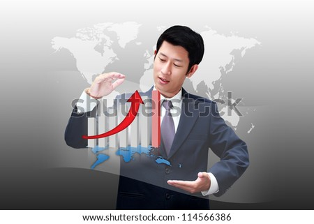 Asian business man holding a chart of his business growth - stock photo