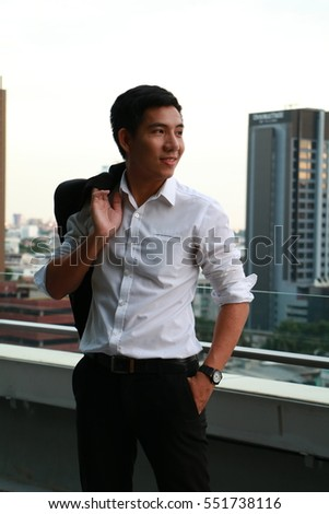 Asian Business man in white shirt and suit
