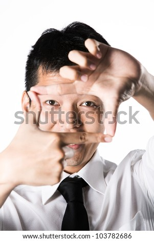 Asian Business man making frame with his hands. - stock photo