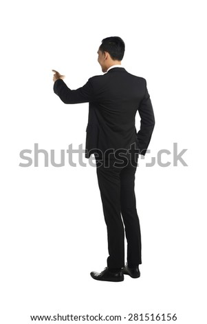 Asian business man pointing something isolated over white background - stock photo