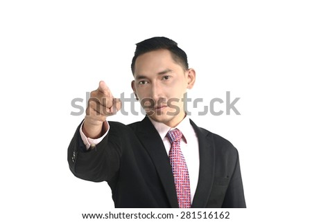 Asian business man pointing something isolated over white background