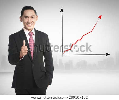 Asian business man show thumb up because sales increasing