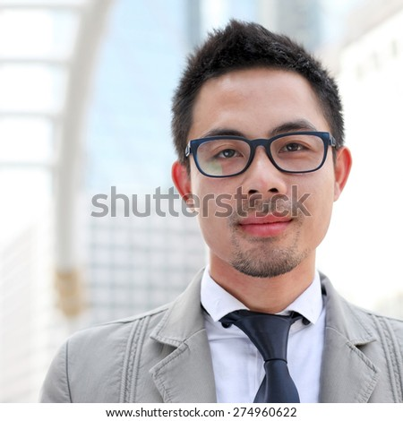 Asian business man smiling  - stock photo
