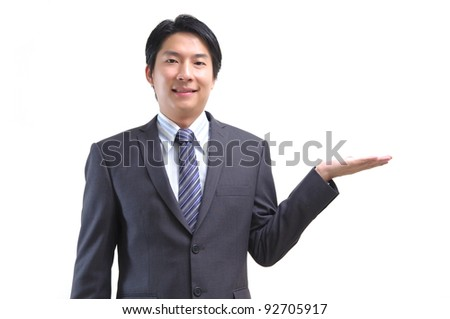 Asian business man standing with open hand isolated on white - stock photo
