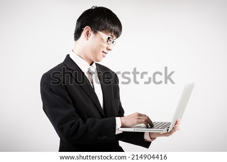 Asian business man using laptop computer isolated on white background