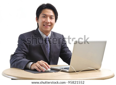 Asian business man using laptop computer isolated on white background - stock photo