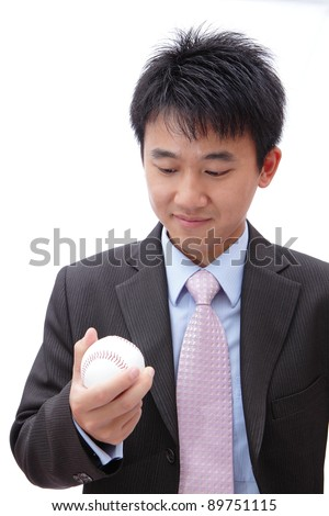 Asian Business man watch ball in the hand - stock photo