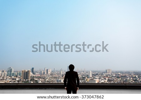 Asian business man who is looking at the city, ready for presentation retouching - stock photo