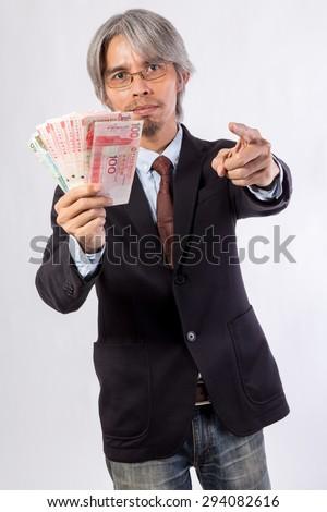 Asian Business man with hongkong Money (HK dollar) - stock photo