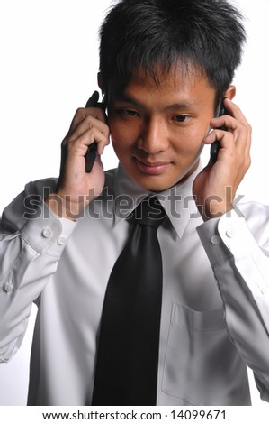 asian business man with multiple handphones - stock photo
