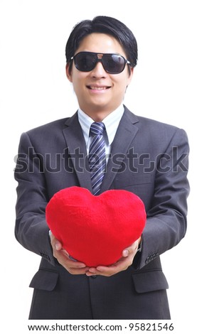 Asian business man with red heart isolated on white (Focus on hand) - stock photo