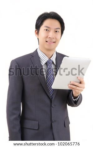 Asian business man with tablet computer isolated on white background - stock photo
