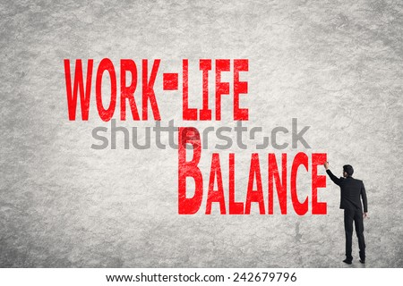 Asian business man write words on wall, Work-Life Balance - stock photo