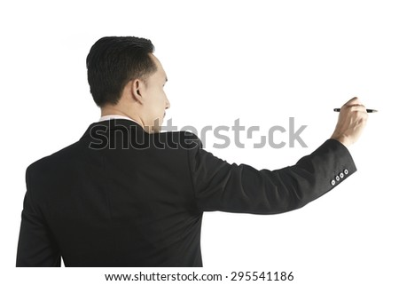 Asian business man writing something with pen isolated over white background