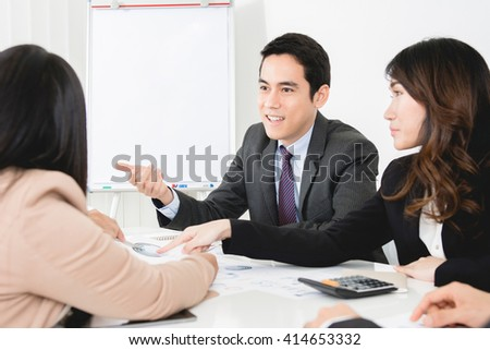 Asian business people at the meeting - stock photo