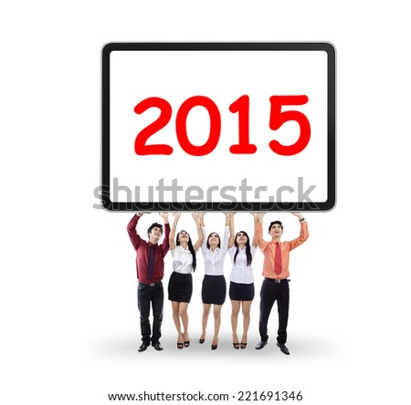 Asian business people holding a billboard with number 2015 - stock photo