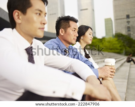 asian business people looking depressed.  - stock photo