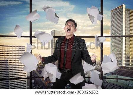 Asian business person depressed on the office. Business problem concept - stock photo