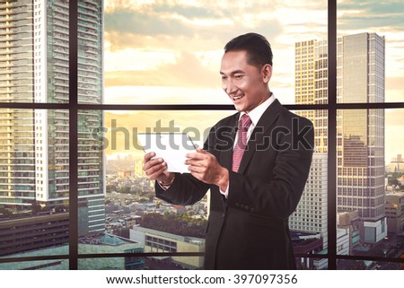 Asian business person working via gadget. Business solution concept
