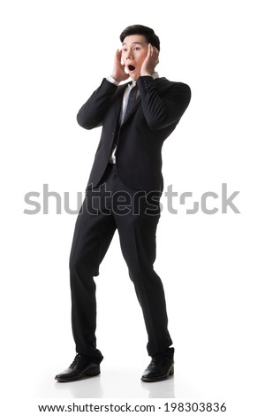 Asian business surprised with outrageously and funny pose, full length portrait isolated on white background. - stock photo