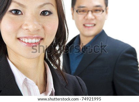 Asian business team, focus is on the woman. - stock photo