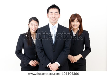 asian business team standing isolated on white background - stock photo