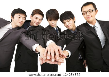 asian business team with hand together - stock photo