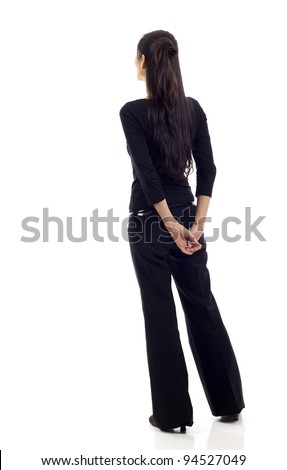 Asian business woman from the back looking at something isolated over white background - stock photo
