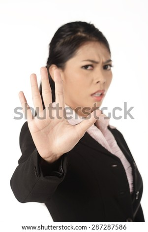 Asian business woman gesturing stop isolated over white background - stock photo