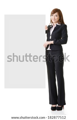 Asian business woman hold empty blank board, full length portrait isolated on white background. - stock photo