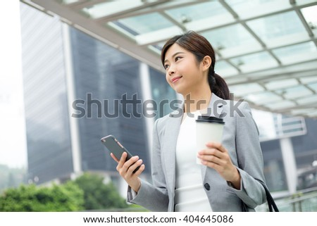 Asian business woman hold with mobile phone - stock photo