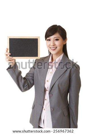 Asian business woman holding blank blackboard on white background.