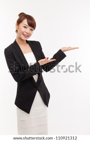 Asian business woman indicate blank space isolated - stock photo