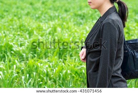 Asian business woman on green background