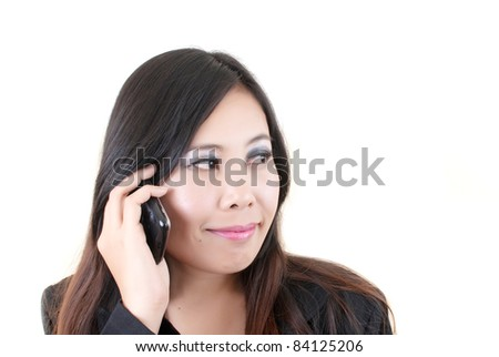 Asian business woman on telephone smiling.