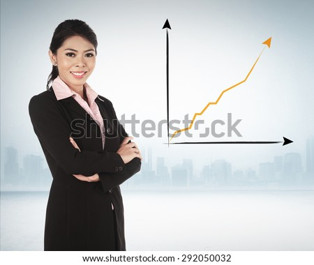 Asian business woman smiling over chart on the background
