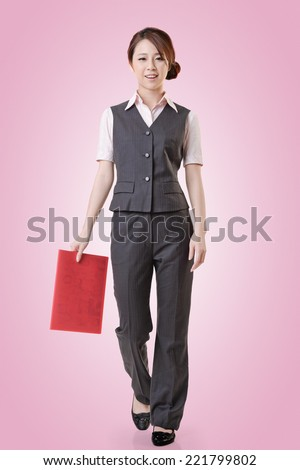 Asian business woman standing against studio background, full length portrait with clipping path. - stock photo