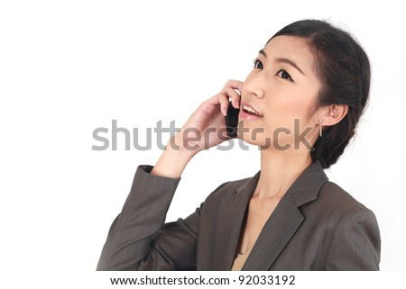 Asian Business woman talking on the phone isolated over a white background - stock photo