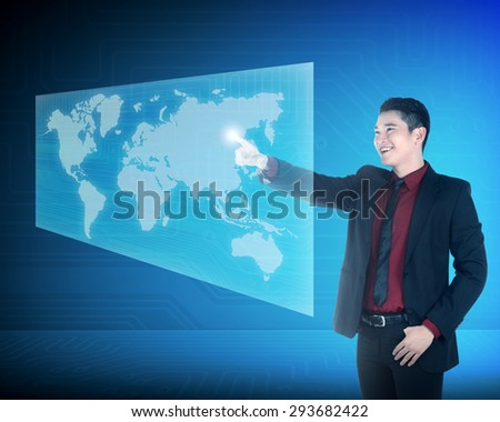 Asian business woman touching world on virtual screen. Globalization business concept - stock photo