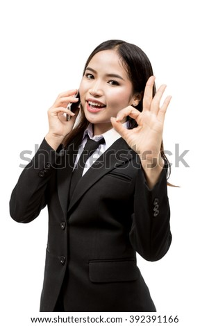asian business woman using her smartphone on white background