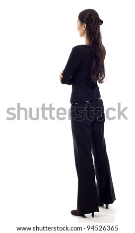 Asian business woman with arm crossed from the back - looking at something isolated over white background