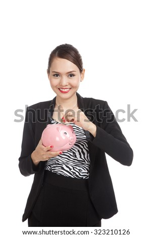 Asian business woman with coin and pig coin bank  isolated on white background