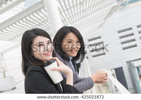 Asian business woman with her colleague. - stock photo